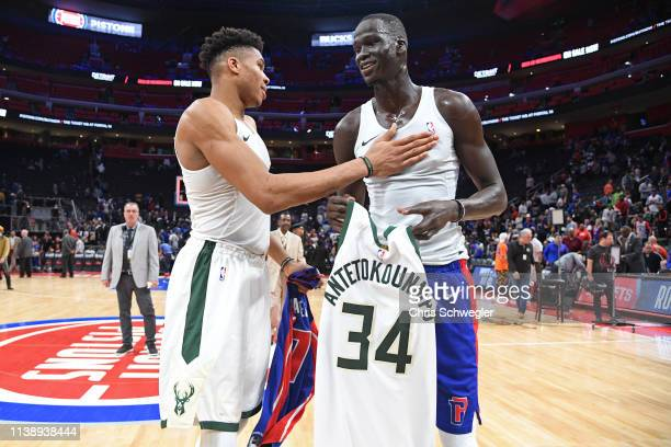 Giannis Antetokounmpo of the Milwaukee Bucks and Thon Maker of the Detroit Pistons exchange jerseys after Game Four of Round One of the 2019 NBA...