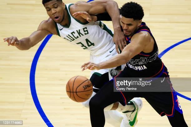 Giannis Antetokounmpo of the Milwaukee Bucks and Tobias Harris of the Philadelphia 76ers vie for the ball during the first quarter at the Wells Fargo...