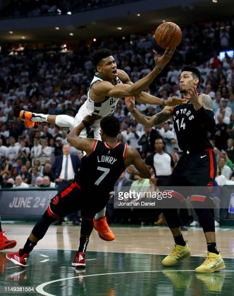 Giannis Antetokounmpo of the Milwaukee Bucks attempts a shot while being guarded by Kyle Lowry of the Toronto Raptors in the third quarter in Game...
