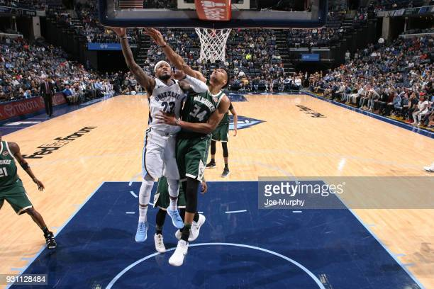 Giannis Antetokounmpo of the Milwaukee Bucks attempts to block the shot by Ben McLemore of the Memphis Grizzlies during the game on March 12 2018 at...
