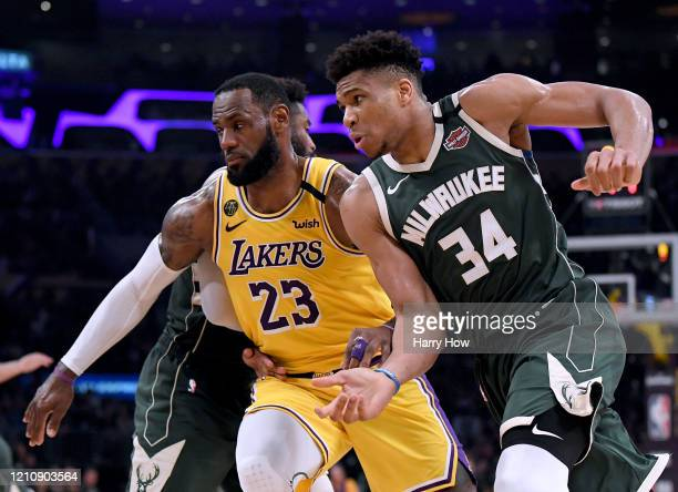Giannis Antetokounmpo of the Milwaukee Bucks attempts to get open as LeBron James of the Los Angeles Lakers defends during the third quarter at...