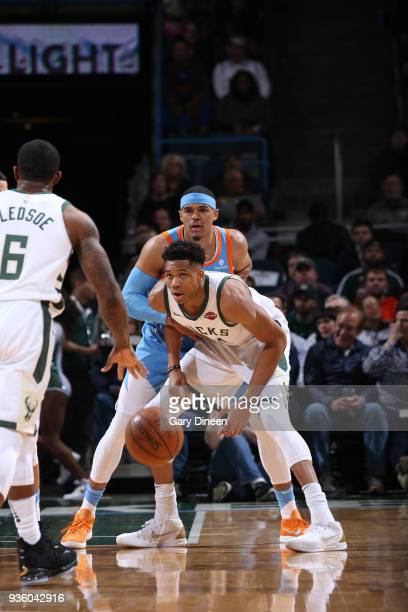 Giannis Antetokounmpo of the Milwaukee Bucks battles for position against Tobias Harris of the Los Angeles Clippers during the NBA game on March 21...