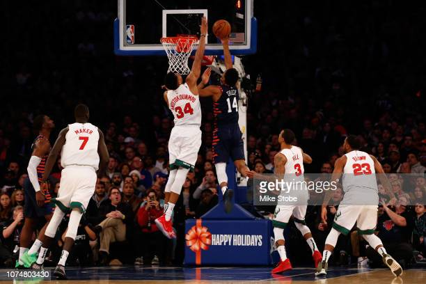 Giannis Antetokounmpo of the Milwaukee Bucks blocks a shot by Allonzo Trier of the New York Knicks at Madison Square Garden on December 25 2018 in...