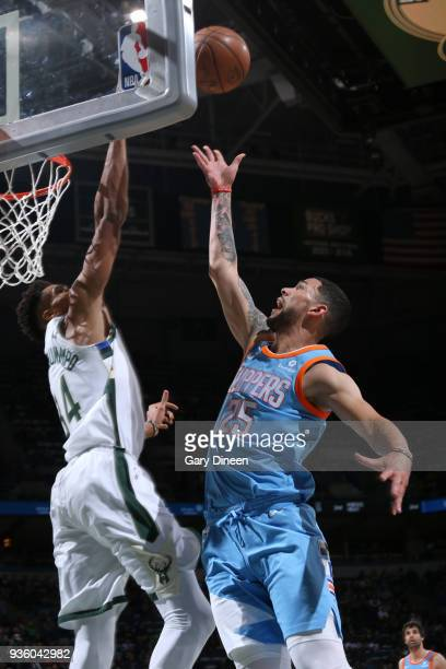 Giannis Antetokounmpo of the Milwaukee Bucks blocks a shot by Austin Rivers of the Los Angeles Clippers during the NBA game on March 21 2018 at the...