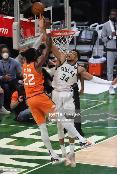 Giannis Antetokounmpo of the Milwaukee Bucks blocks a shot by Deandre Ayton of the Phoenix Suns during the second half in Game Four of the NBA Finals...