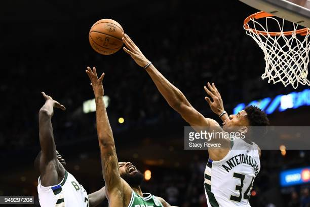 Giannis Antetokounmpo of the Milwaukee Bucks blocks a shot by Marcus Morris of the Boston Celtics during the first half of game three of round one of...