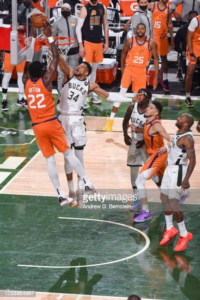 Giannis Antetokounmpo of the Milwaukee Bucks blocks Deandre Ayton of the Phoenix Suns during Game Four of the 2021 NBA Finals on July 14, 2021 at the...