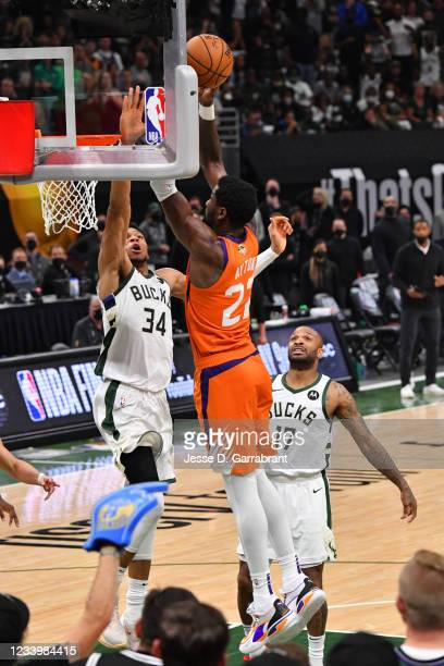 Giannis Antetokounmpo of the Milwaukee Bucks blocks the dunk of Deandre Ayton of the Phoenix Suns during Game Four of the 2021 NBA Finals on July 14,...