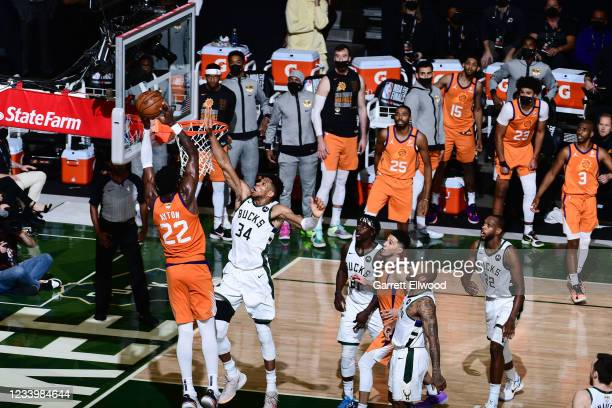 July 14: Giannis Antetokounmpo of the Milwaukee Bucks blocks the shot of Deandre Ayton of the Phoenix Suns during Game Four of the 2021 NBA Finals on...