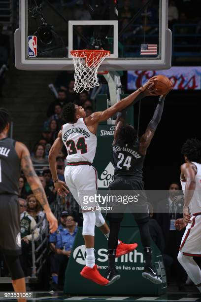Giannis Antetokounmpo of the Milwaukee Bucks blocks the shot of Rondae HollisJefferson of the Brooklyn Nets on January 26 2018 at the BMO Harris...