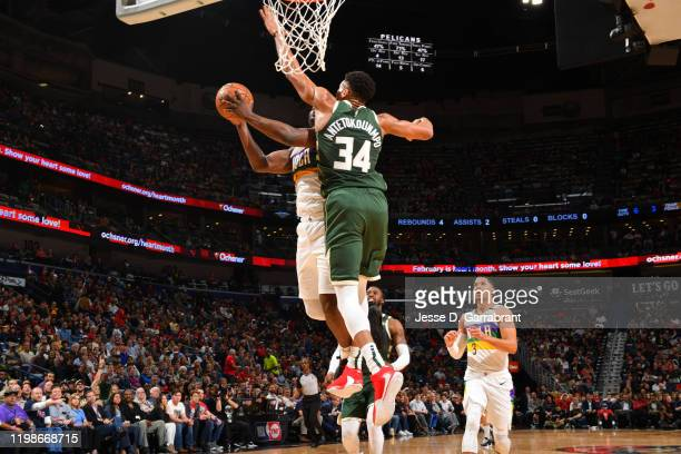Giannis Antetokounmpo of the Milwaukee Bucks blocks the shot of Zion Williamson of the New Orleans Pelicans on February 4, 2020 at the Smoothie King...