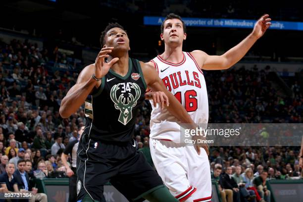 Giannis Antetokounmpo of the Milwaukee Bucks boxes out against the Chicago Bulls on December 15 2017 at the BMO Harris Bradley Center in Milwaukee...
