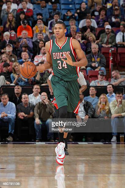 Giannis Antetokounmpo of the Milwaukee Bucks brings the ball up the court against the Sacramento Kings on December 18 2014 at Sleep Train Arena in...