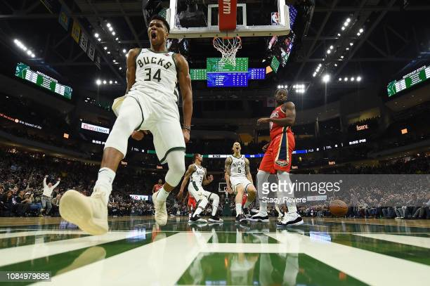 Giannis Antetokounmpo of the Milwaukee Bucks celebrates after scoring against the New Orleans Pelicans during a game at Fiserv Forum on December 19...