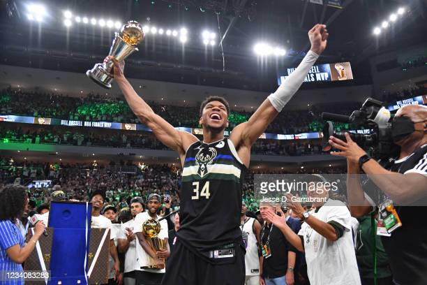 Giannis Antetokounmpo of the Milwaukee Bucks celebrates after receiving the Bill Russell Finals MVP Award after winning Game Six of the 2021 NBA...