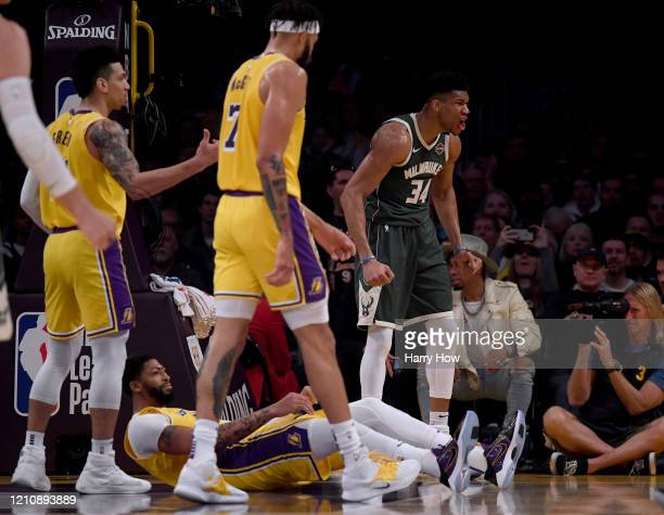 Giannis Antetokounmpo of the Milwaukee Bucks celebrates his basket and a Anthony Davis of the Los Angeles Lakers blocking foul during the first half...
