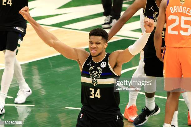 Giannis Antetokounmpo of the Milwaukee Bucks celebrates in the final second before defeating the Phoenix Suns in Game Six to win the 2021 NBA Finals...