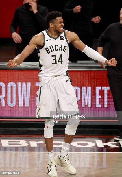 Giannis Antetokounmpo of the Milwaukee Bucks celebrates the win of game seven of the Eastern Conference second round at Barclays Center on June 19,...