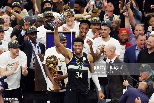 Giannis Antetokounmpo of the Milwaukee Bucks celebrates winning the Bill Russell NBA Finals MVP Award after defeating the Phoenix Suns in Game Six to...