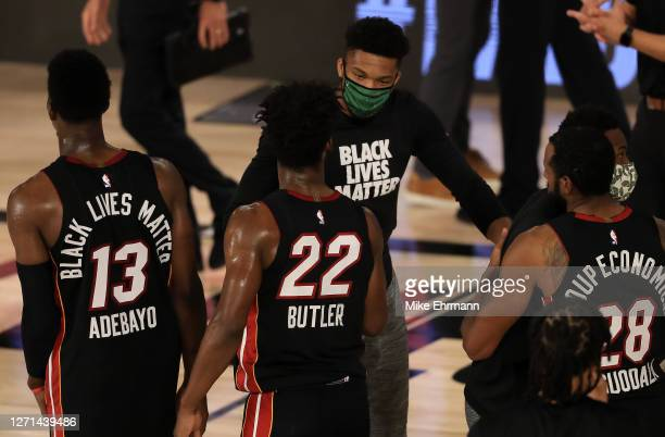 Giannis Antetokounmpo of the Milwaukee Bucks congratulates Jimmy Butler of the Miami Heat after their win in Game Five of the Eastern Conference...