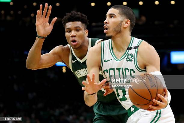 Giannis Antetokounmpo of the Milwaukee Bucks defends Jayson Tatum of the Boston Celtics during the second quarter of Game 3 of the Eastern Conference...