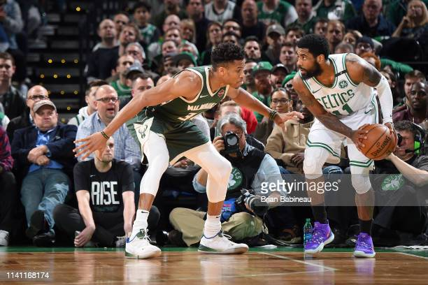 Giannis Antetokounmpo of the Milwaukee Bucks defends Kyrie Irving of the Boston Celtics during Game Three of the Eastern Conference Semifinals of the...
