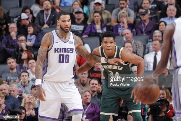 Giannis Antetokounmpo of the Milwaukee Bucks defends Willie CauleyStein of the Sacramento Kings on November 28 2017 at Golden 1 Center in Sacramento...