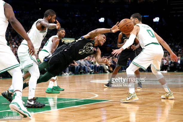 Giannis Antetokounmpo of the Milwaukee Bucks dives after being fouled by Kyrie Irving of the Boston Celtics during the second half at TD Garden on...