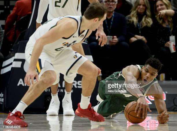Giannis Antetokounmpo of the Milwaukee Bucks dives under Bojan Bogdanovic of the Utah Jazz during a game at Vivint Smart Home Arena on November 8...