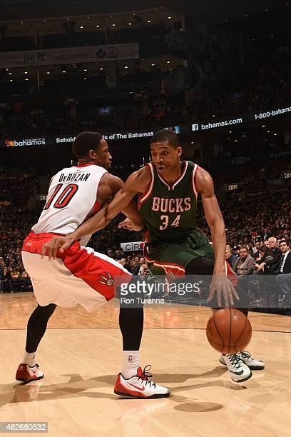 Giannis Antetokounmpo of the Milwaukee Bucks dribbles against DeMar DeRozan of the Toronto Raptors on February 2 2015 at the Air Canada Centre in...