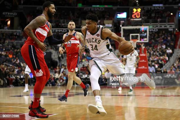 Giannis Antetokounmpo of the Milwaukee Bucks dribbles in front of Markieff Morris of the Washington Wizards during the first half at Capital One...