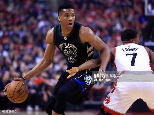 Giannis Antetokounmpo of the Milwaukee Bucks dribbles the ball as Kyle Lowry of the Toronto Raptors defends in the first half of Game One of the...