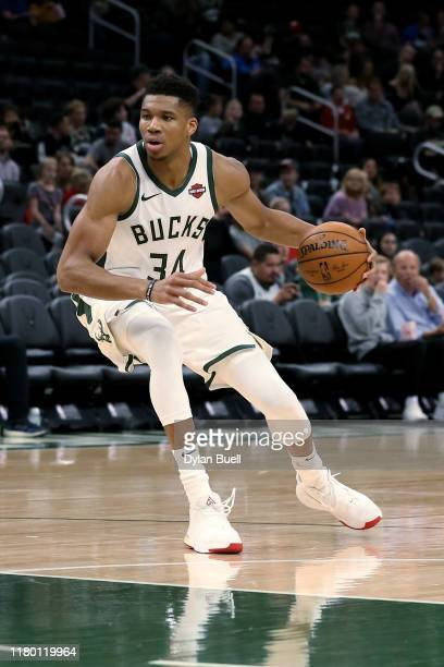 Giannis Antetokounmpo of the Milwaukee Bucks dribbles the ball in the third quarter against the Utah Jazz during a preseason game at Fiserv Forum on...