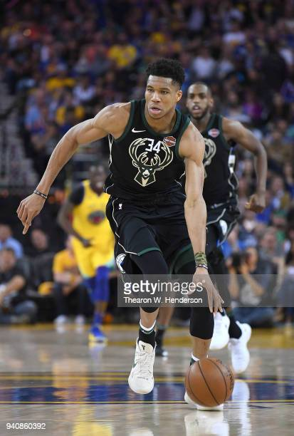 Giannis Antetokounmpo of the Milwaukee Bucks dribbles the ball up court against the Golden State Warriors during an NBA basketball game at ORACLE...