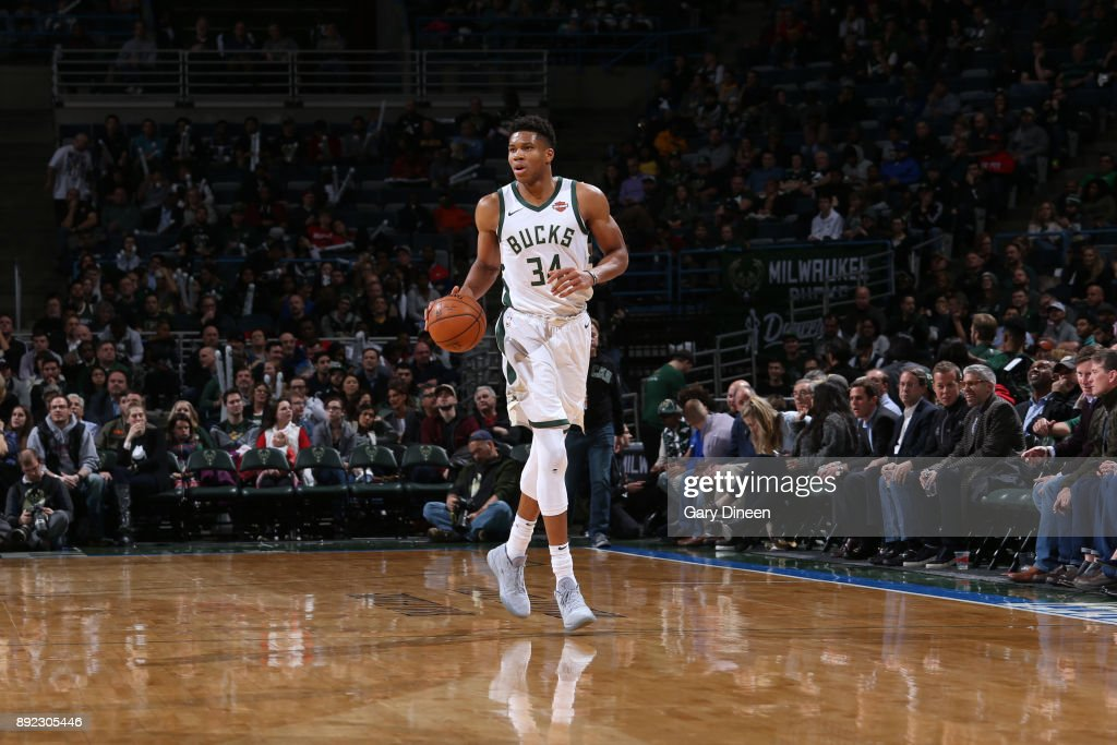 Giannis Antetokounmpo #34 of the Milwaukee Bucks dribbles the ball up the court during the game against the Detroit Pistons on December 6, 2017 at the BMO Harris Bradley Center in Milwaukee, Wisconsin.