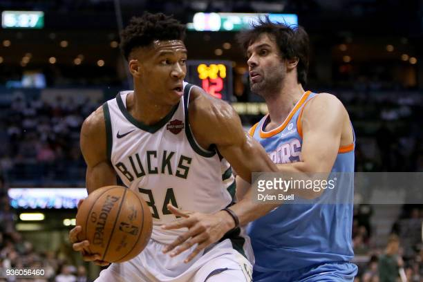 Giannis Antetokounmpo of the Milwaukee Bucks dribbles the ball while being guarded by Milos Teodosic of the Los Angeles Clippers in the second...