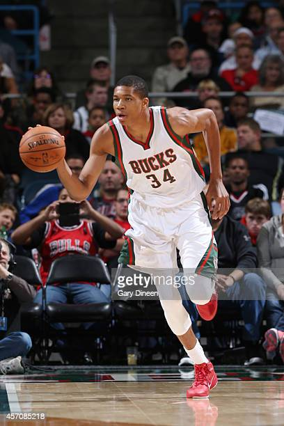 Giannis Antetokounmpo of the Milwaukee Bucks dribbles up the court against the Chicago Bulls during the game on October 11 2014 at BMO Harris Bradley...