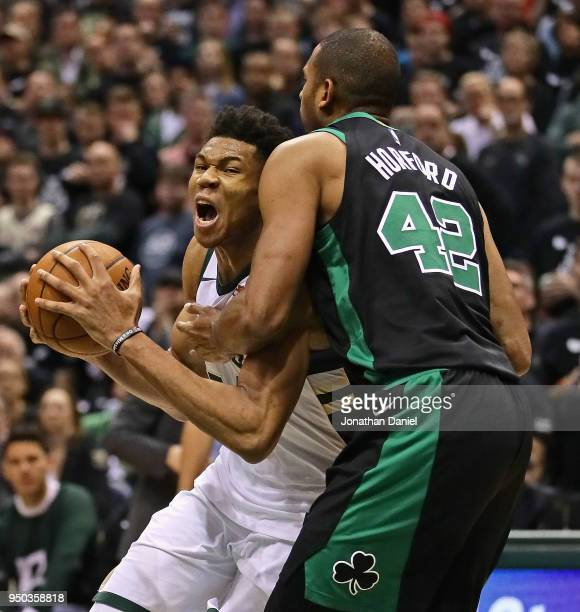 Giannis Antetokounmpo of the Milwaukee Bucks drives against Al Horford of the Boston Celtics during Game Four of Round One of the 2018 NBA Playoffs...