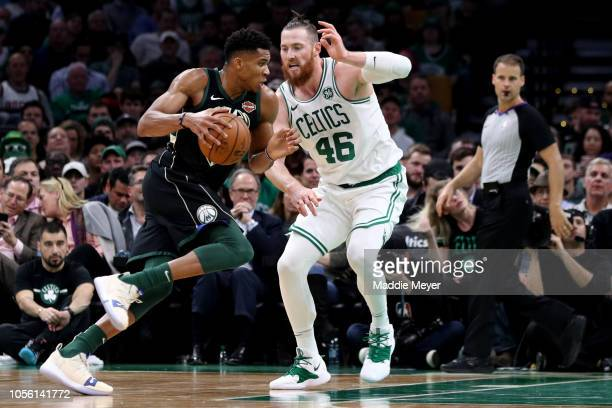 Giannis Antetokounmpo of the Milwaukee Bucks drives against Aron Baynes of the Boston Celtics during the game between the Boston Celtics and the...