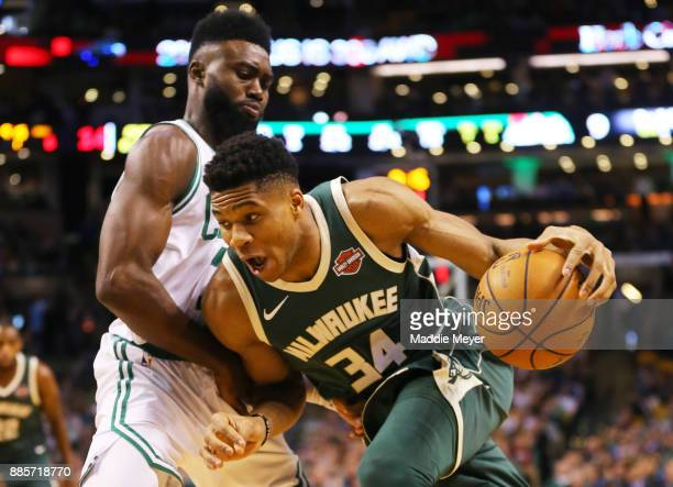 Giannis Antetokounmpo of the Milwaukee Bucks drives against Jaylen Brown of the Boston Celtics during the first quarter at TD Garden on December 4...