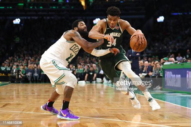Giannis Antetokounmpo of the Milwaukee Bucks drives against Kyrie Irving of the Boston Celtics during the second half of Game 3 of the Eastern...