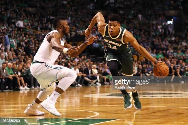 Giannis Antetokounmpo of the Milwaukee Bucks drives against Semi Ojeleye of the Boston Celtics during the first quarter of Game Seven in Round One of...