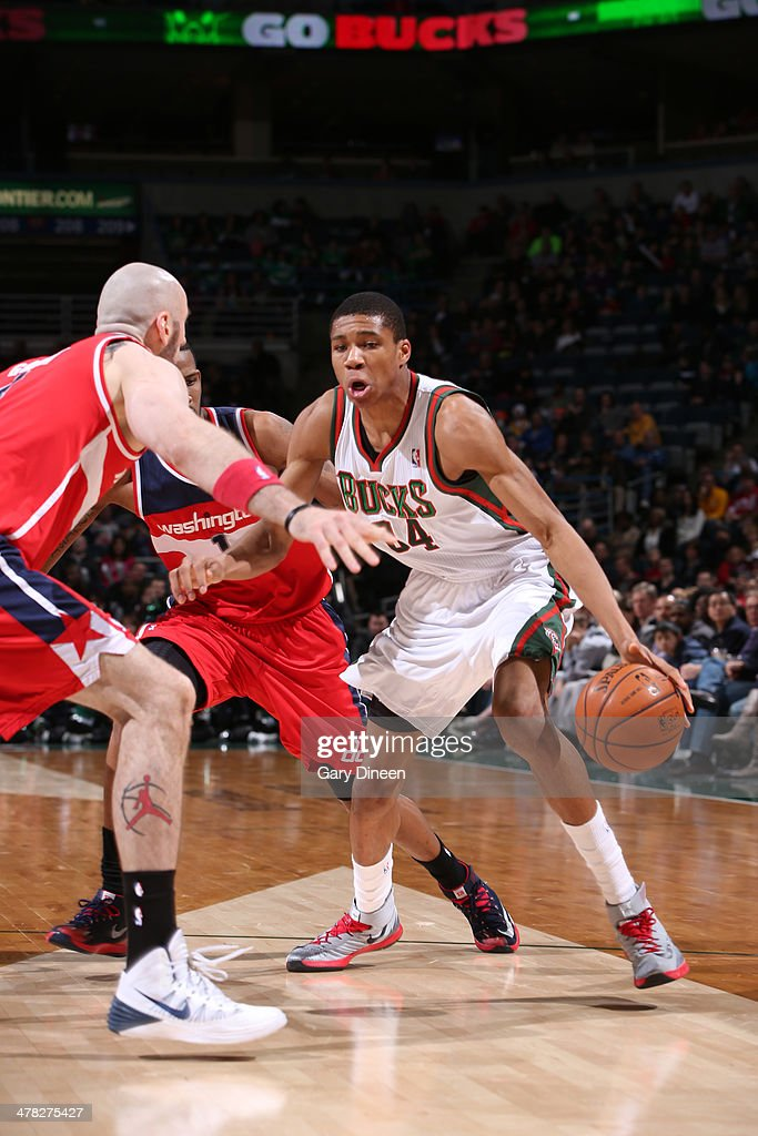 Giannis Antetokounmpo #34 of the Milwaukee Bucks drives against the Washington Wizards on March 8, 2014 at the BMO Harris Bradley Center in Milwaukee, Wisconsin.