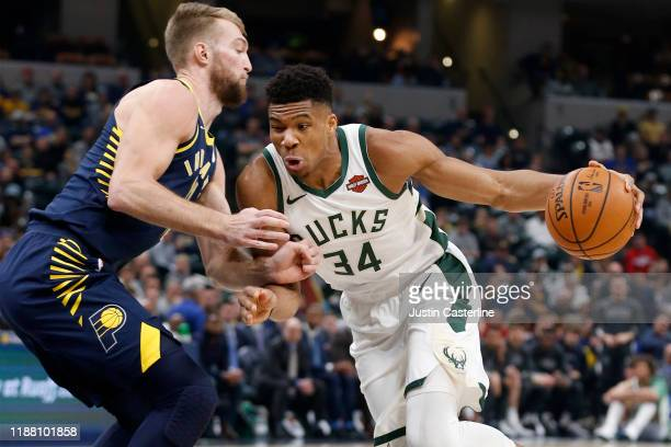 Giannis Antetokounmpo of the Milwaukee Bucks drives to the basket in the game against the Indiana Pacers during the first quarter at Bankers Life...