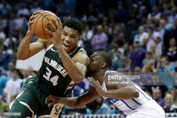 Giannis Antetokounmpo of the Milwaukee Bucks drives to the basket against Kemba Walker of the Charlotte Hornets during their game at Spectrum Center...