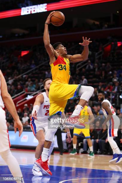 Giannis Antetokounmpo of the Milwaukee Bucks drives to the basket past Blake Griffin of the Detroit Pistons during the second half at Little Caesars...