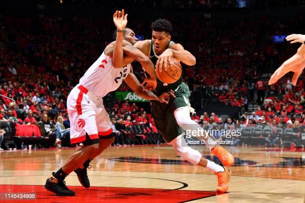 Giannis Antetokounmpo of the Milwaukee Bucks drives to the basket against Kawhi Leonard of the Toronto Raptors during Game Four of the Eastern...