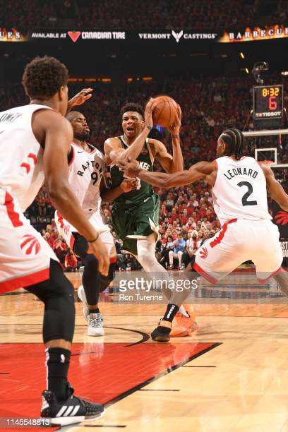 Giannis Antetokounmpo of the Milwaukee Bucks drives to the basket against the Toronto Raptors during Game Four of the Eastern Conference Finals on...