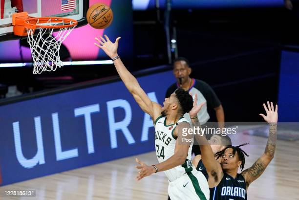Giannis Antetokounmpo of the Milwaukee Bucks drives to the basket over Markelle Fultz of the Orlando Magic during the first half of an NBA basketball...