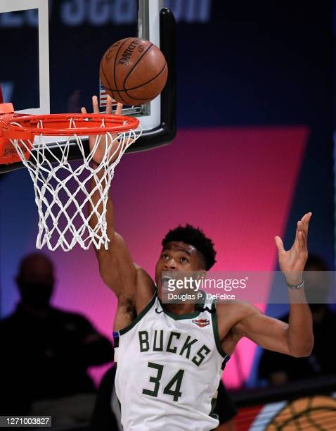 Giannis Antetokounmpo of the Milwaukee Bucks drives to the basket during the first quarter against the Miami Heat in Game Four of the Eastern...